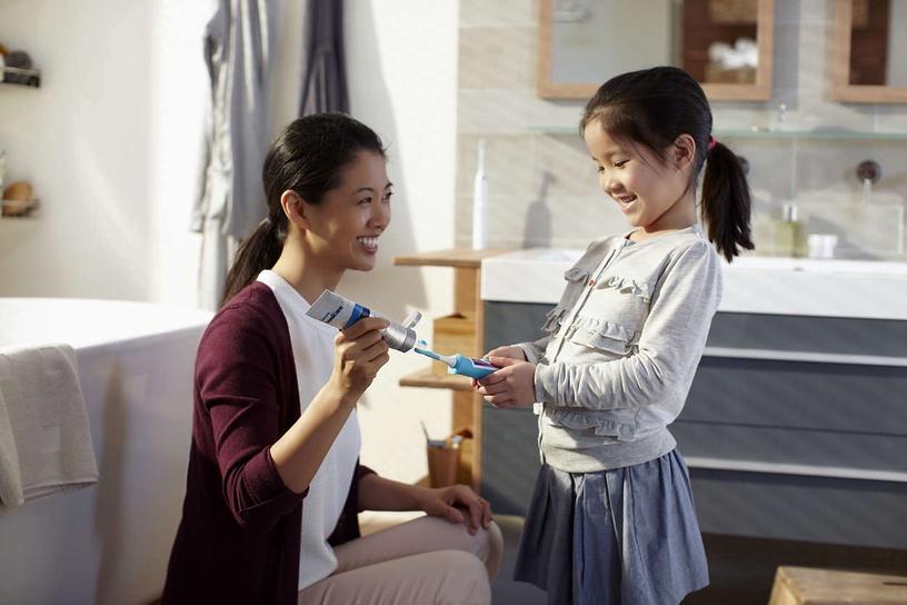 Электрическая зубная щетка Philips HX6322/04, белый/зеленый